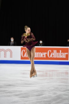 Lindsay Thorngren mid-jump on the ice