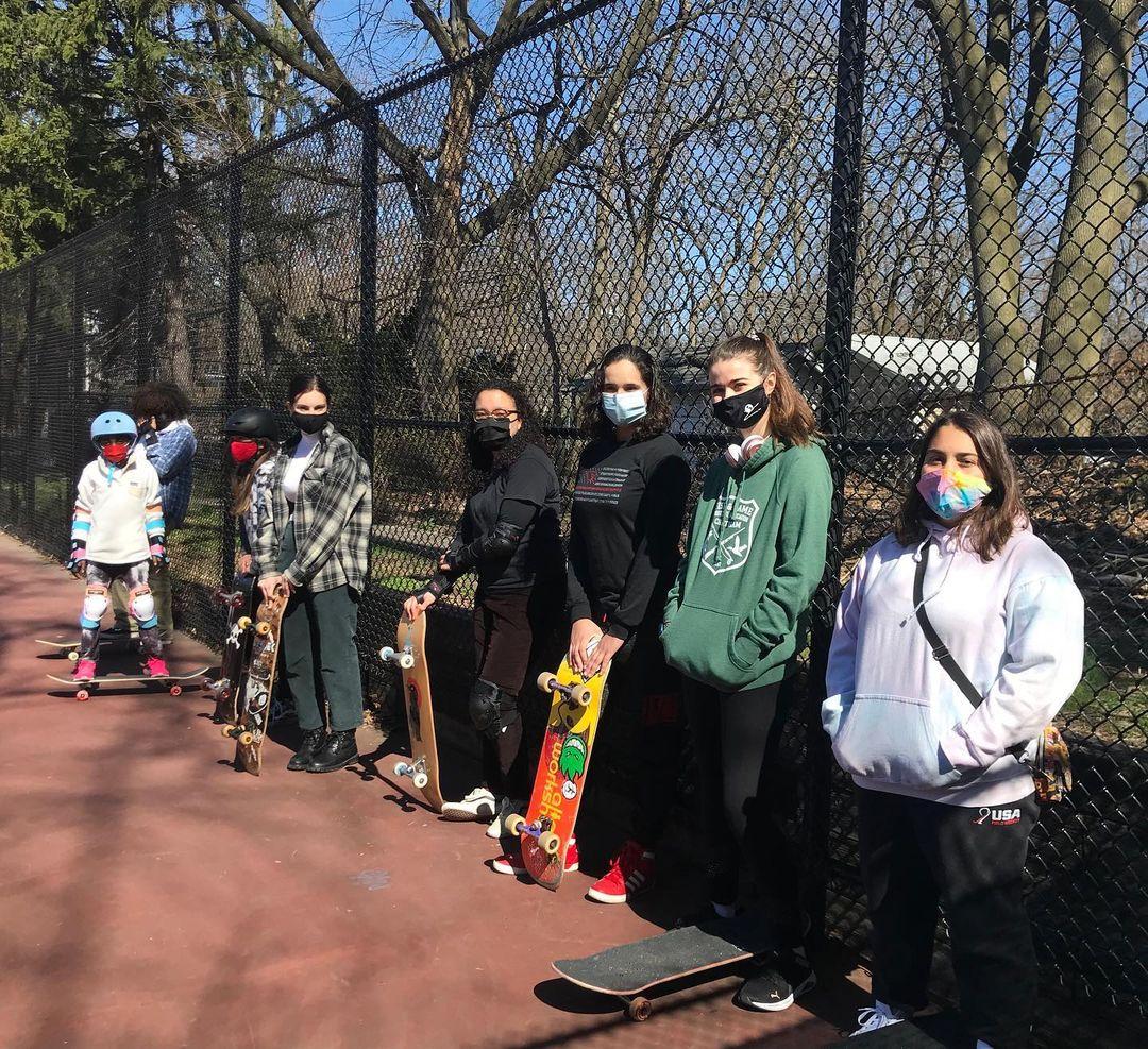 Boardroom skate members pose in a line
